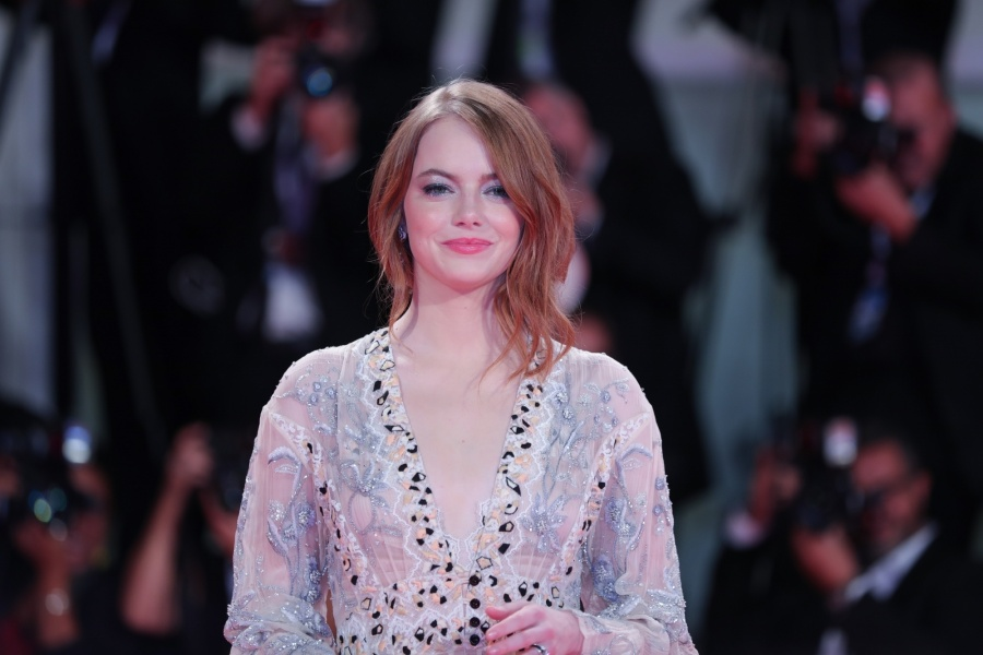 """VENICE (ITALY), Aug. 30, 2018 (Xinhua) -- Actress Emma Stone attends the premiere of film """"The Favourite"""" at the 75th Venice International Film Festival in Venice, Italy, Aug. 30, 2018. (Xinhua/Cheng Tingting/IANS) by ."""