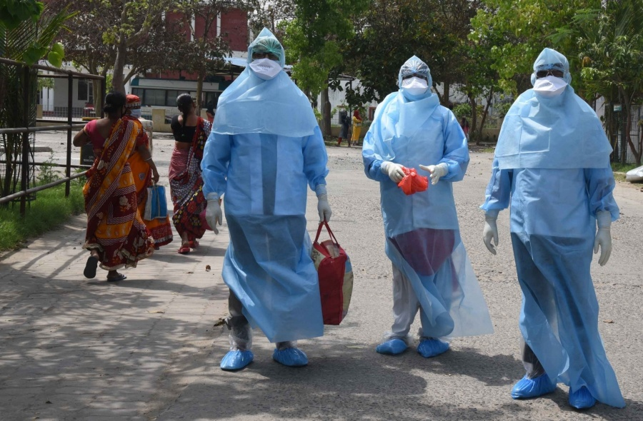 Patna: Members of a medical team wearing Personal Protective Equipment (PPE) suits arrive at a Patna residential area to take samples of suspected COVID-19 patients during the 21-day nationwide lockdown (that entered the 15th day) imposed as a precautionary measure to contain the spread of coronavirus, on Apr 8, 2020. (Photo: IANS) by .