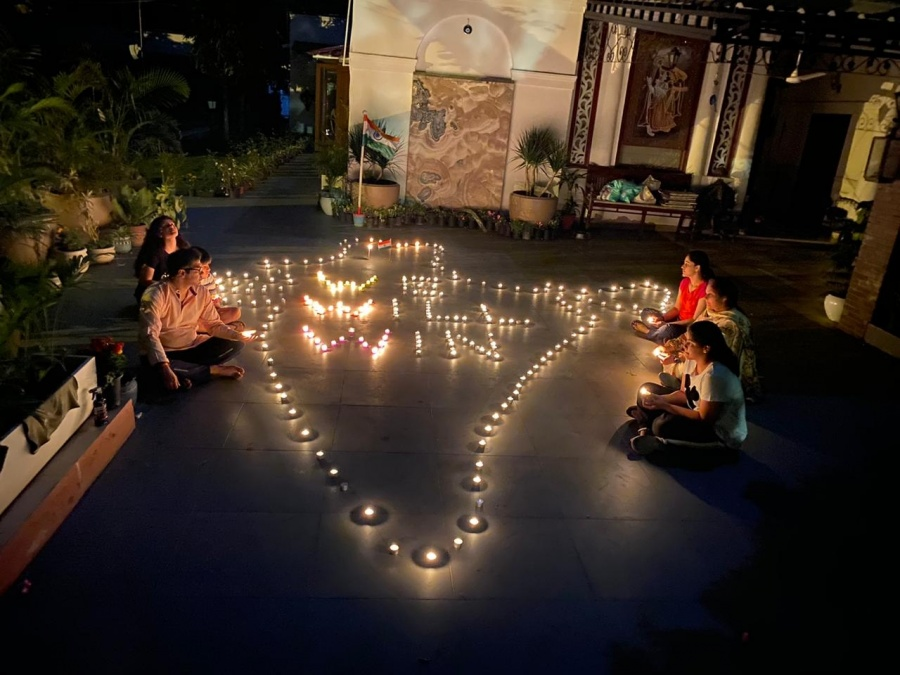 New Delhi: People light 'diyas' and candles in their balconies after Prime Minister Narendra Modi urged people in a video message to the nation to turn off their lights for nine minutes at 09:00 pm on April 5 and light a candle or a 'diya' or even use the flashlight to mark the country' fight against COVID-19 pandemic in New Delhi on April 5, 2020. (Photo: IANS) by .