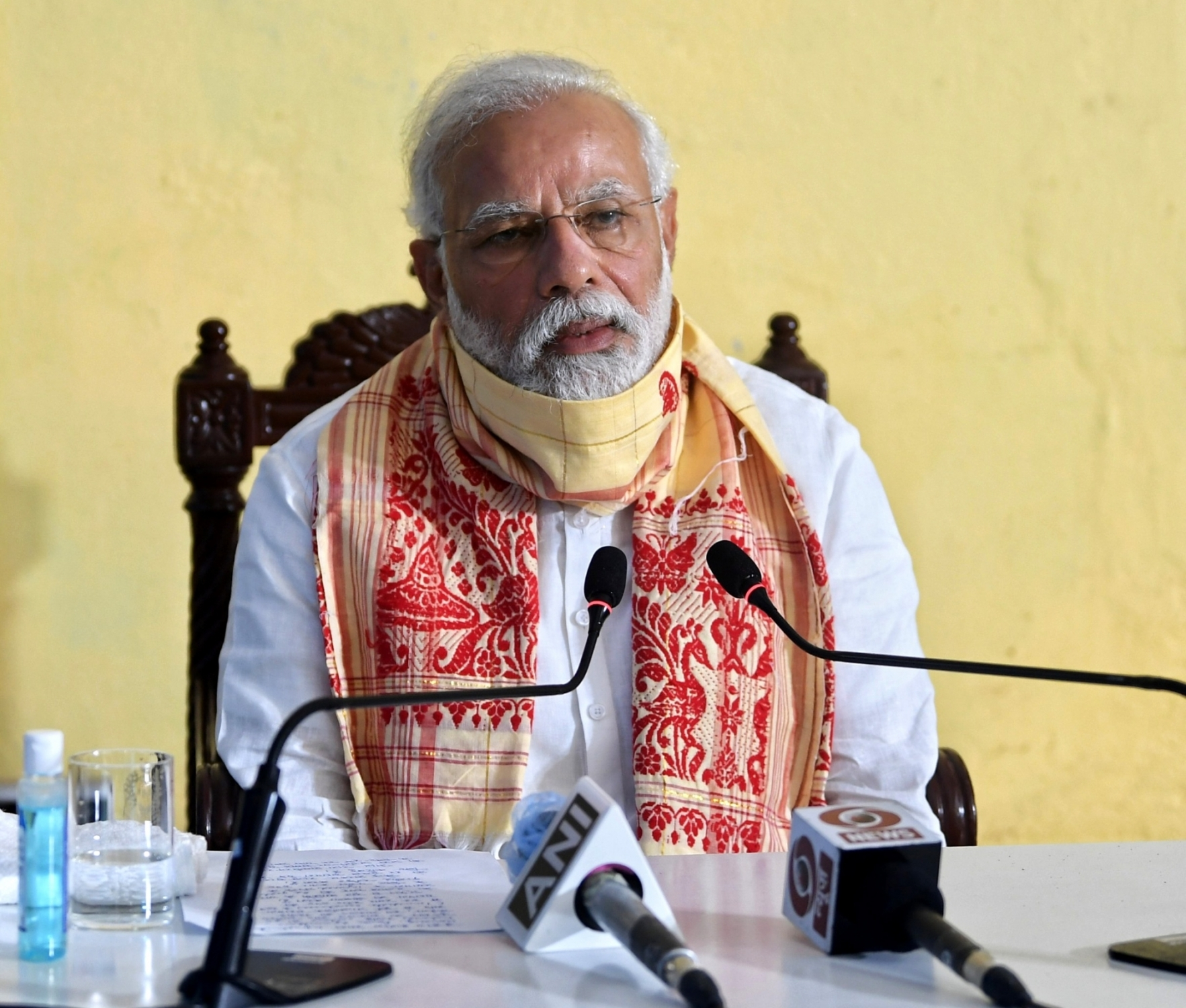 Kolkata: Prime Minister Narendra Modi holds review meeting with the officials at Basirhat, West Bengal after his aerial survey of cyclone Amphan-affected areas of the state, on May 22, 2020. (Photo: IANS/PIB) by .