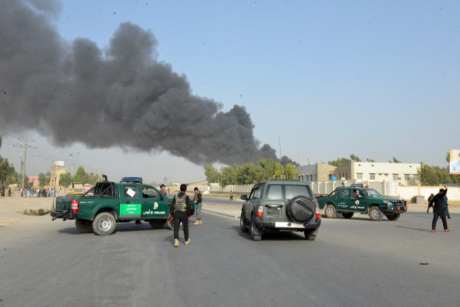 KANDAHAR, July 18, 2019 (Xinhua) -- Members of Afghan security forces stand guard at the site of the attack outside the provincial police headquarters in Kandahar, capital of Afghanistan's southern Kandahar province, July 18, 2019. At least 12 people were killed and over 90 others injured after a Taliban car bombing and ensuing gun fire rocked provincial police headquarters in Kandahar city, capital of Afghanistan's southern Kandahar province, on Thursday, witnesses said. (Xinhua/Sanaullah Seiam/IANS) by .