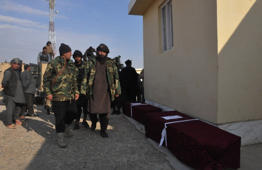 SHIBERGHAN, Dec. 30, 2019 (Xinhua) -- Afghan security force members walk past coffins of comrades killed in a checkpoint attack by Taliban militants in Faiz Abad district of Jawzjan province, Afghanistan, Dec. 30, 2019.n A total of 14 Afghan security force members were killed after Taliban militants stormed a security checkpoint in Afghanistan's northern province of Jawzjan on Monday, a provincial government spokesman said. (Photo by Mohammad Jan Aria/Xinhua/IANS) by .