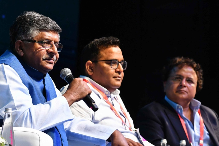 New Delhi: Union Law and Justice, Communications and Electronics and Information Technology Minister Ravi Shankar Prasad accompanied by Paytm Founder Vijay Shekhar Sharma, Lava CMD Hari Om Rai, addresses at India Mobile Congress 2019 in New Delhi on Oct 14, 2019. (Photo: Amlan Paliwal/IANS) by .