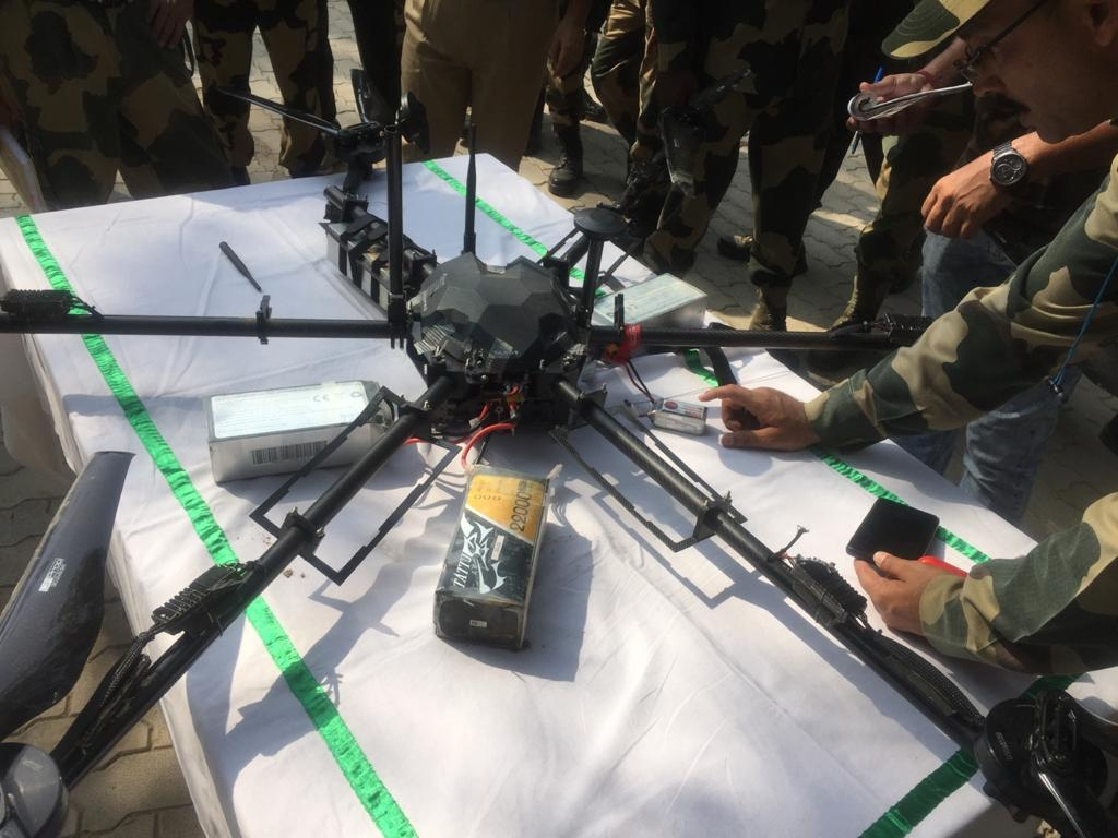 BSF shoots down Pak drone carrying weapons in J&K's Kathua. by .