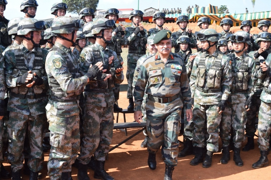 "Shillong: Soldiers of the Indian and the Chinese Army during the closing ceremony of the eighth edition of India-China Joint Training Exercise ""Hand-in- Hand"" 2019, at Joint Training Node, Umroi Miitary Station in Meghalaya's capital Shillong on Dec 20, 2019. (Photo: IANS/DPRO) by ."