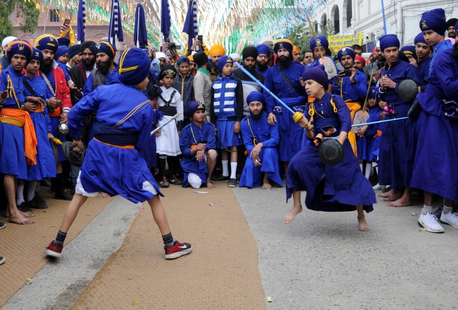 Amritsar: Sikh devotees perform martial arts 'Gatka' during 'Nagar Kirtan' procession near Golden Temple organised on the eve of the 338th birth anniversary of Sikh warrior Shaheed Baba Deep Singh in Amritsar on Jan 25, 2020. (Photo: IANS) by .