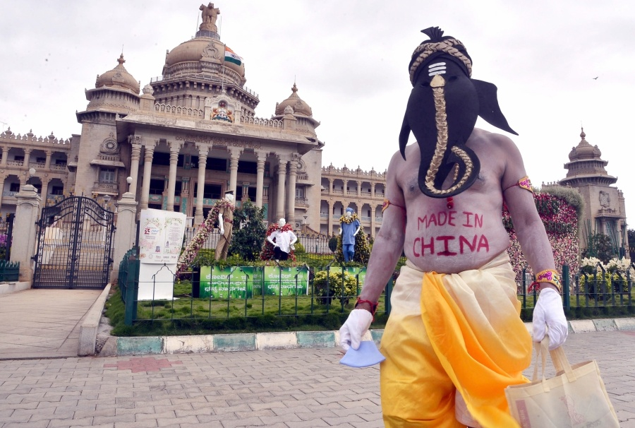 Bengaluru: Artiste Paramesh Jolad dressed up as Lord Ganesha spreads awareness urging people to boycott Chinese products and use only domestic products, in front of Vidhana Soudha in Bengaluru on June 13, 2020. (Photo: IANS) by .