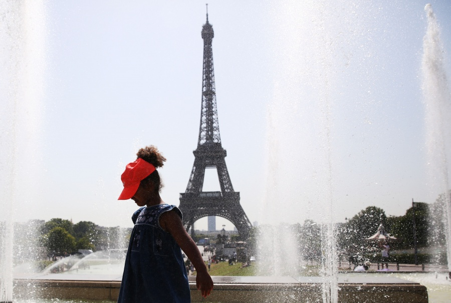 PARIS, July 25, 2019 (Xinhua) -- A girl poses for a photo with the Eiffel Tower on the backdrop by a fountain at the Trocadero Place in Paris, France, July 25, 2019. Temperature in Paris hit 42 degrees centigrade on Thursday. (Xinhua/Gao Jing/IANS) by .