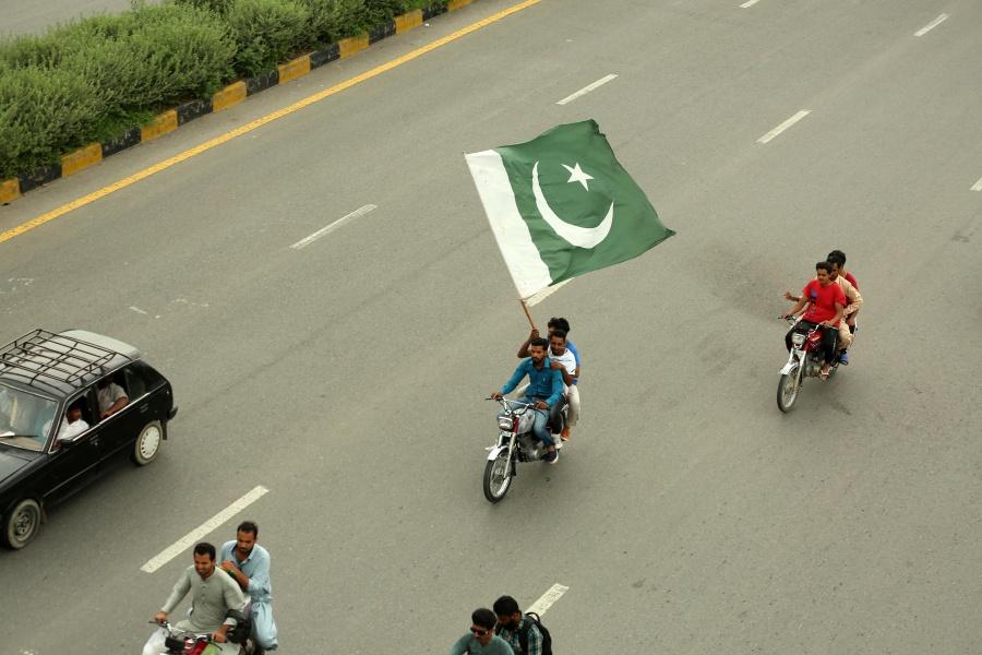 ISLAMABAD, Aug. 14, 2019 (Xinhua) -- A Pakistani man on a motorcycle holds a national flag during the Independence Day celebrations in Islamabad, Pakistan, on Aug. 14, 2019. Pakistan got independence from the British colonial rule on Aug. 14, 1947. (Xinhua/Ahmad Kamal/IANS) by .