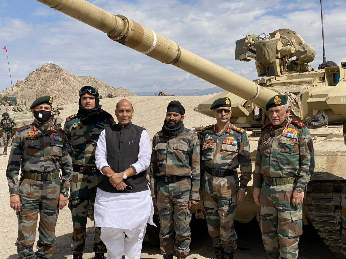 Leh: Defence Minister Rajnath Singh with the troops who participated in the para dropping and other military exercises at Stankna near Leh on July 17, 2020. Also seen Chief of Defence Staff General Bipin Rawat and Army Chief General Manoj Mukund Naravane. (Photo: IANS) by .