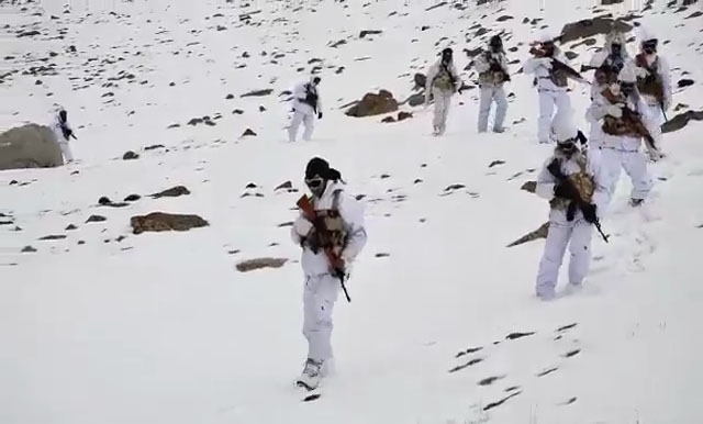 """A video of Indo-Tibetan Border Police (ITBP) personnel is doing the rounds on the Internet with the national flag celebrating Republic Day at 17000 feet in snow today. The temperature in Ladakh at present is minus 20 degrees Celsius. In the 1 min 57 sec video the Indo-Tibetan Border Police's """"Himveers"""" could be seen chanting 'Bharat Mata Ki Jai' and 'Vande Mataram'. by ."""