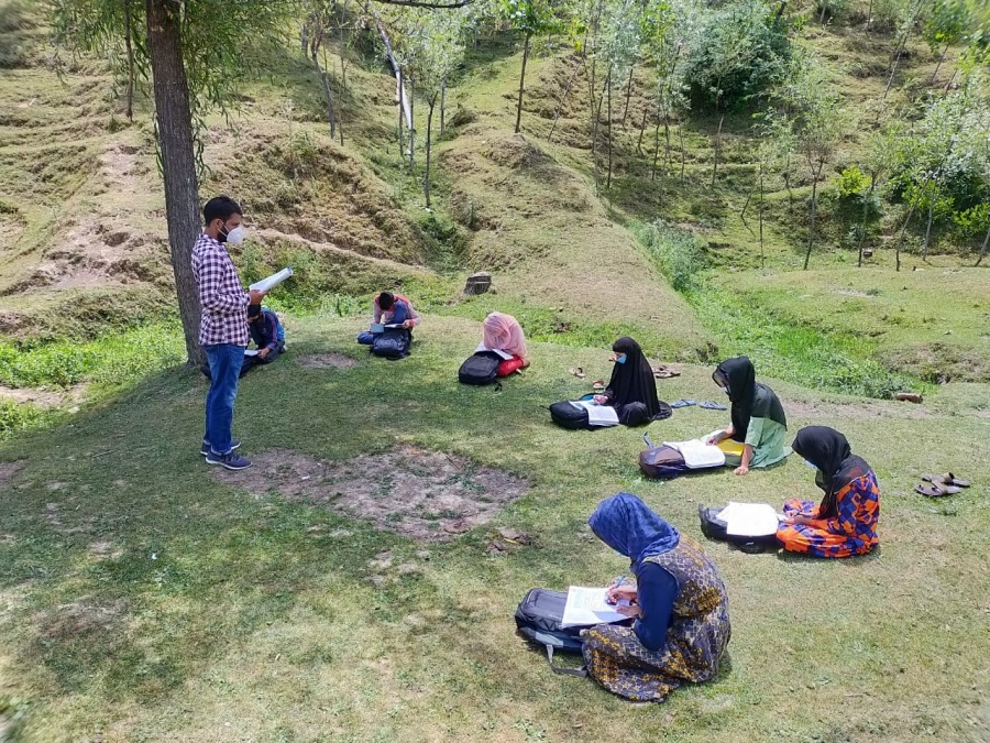 Kandi: Students study during community classes that have been started from today, in Kandi area of Baramulla district in Jammu and Kashmir on July 8, 2020. (Photo: IANS) by .