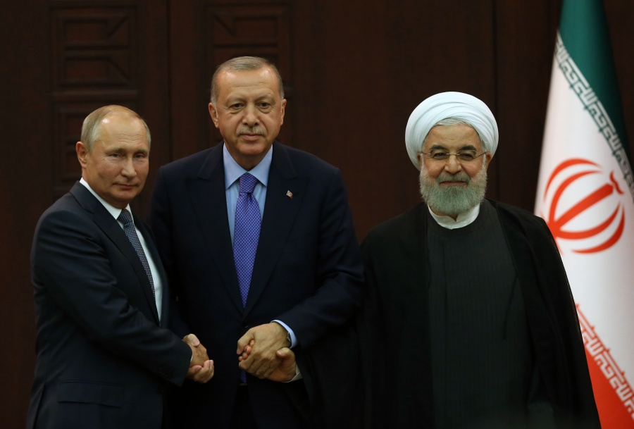 ANKARA, Sept. 16, 2019 (Xinhua) -- Turkish President Recep Tayyip Erdogan (C), Russian President Vladimir Putin (L) and Iranian President Hassan Rouhani pose for a group photo after their summit in Ankara, Turkey, on Sept. 16, 2019. Turkey, Russia and Iran focused on the security issue in Syria on Monday in Ankara during a three-way talk and emphasized the need of a long-lasting truce in the northwestern Idlib region of the war-torn country. (Photo by Mustafa Kaya/Xinhua/IANS) by .