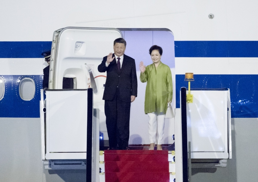 BRASILIA, Nov. 12, 2019 (Xinhua) -- Chinese President Xi Jinping and his wife Peng Liyuan walk out of the plane upon their arrival in Brasilia, Brazil, Nov. 12, 2019. Chinese President Xi Jinping arrived here Tuesday night for the upcoming 11th BRICS summit. (Xinhua/Ding Haitao/IANS) by .
