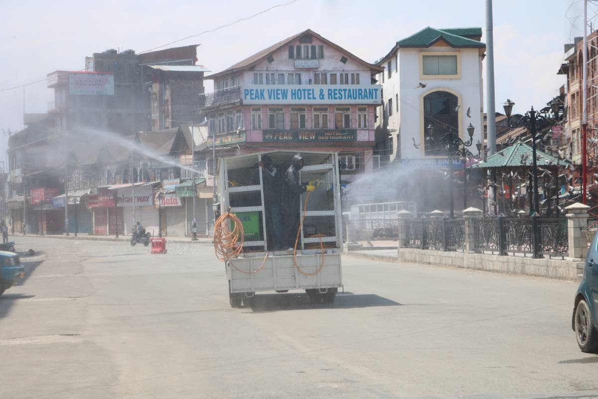 Srinagar: Municipal workers spray disinfectants during a sanitisation drive conducted across Srinagar during the extended nationwide lockdown imposed to mitigate the spread of coronavirus; on Apr 27, 2020. (Photo: IANS) by .