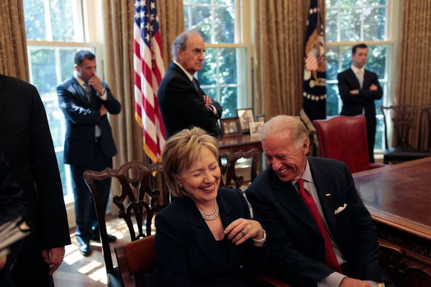 Hillary Clinton and former Vice President Joe Biden in the foreground in a photograph posted on Biden's Twitter account after Clinton endorsed him. by .