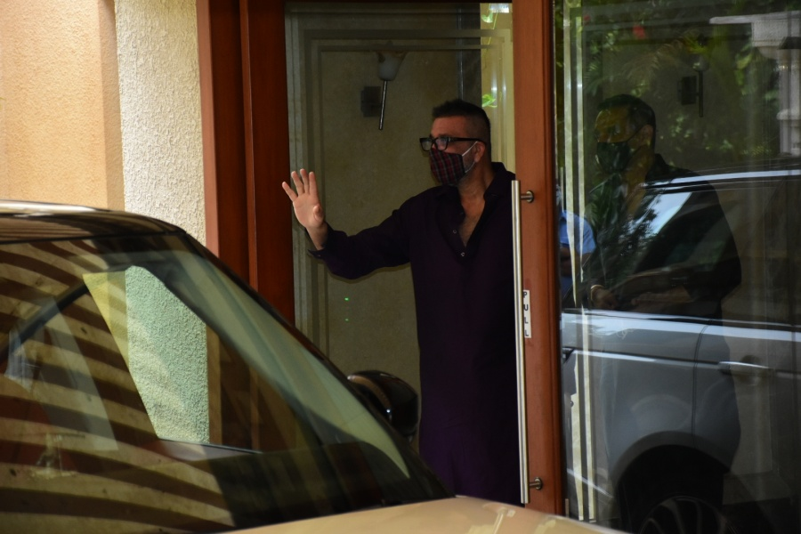 Mumbai: Bollywood actor Sanjay Dutt returns home after being discharged from hospital in Mumbai on Aug 10, 2020. The 61-year-old actor was admitted to Lilavati Hospital on Saturday evening after he complained of breathlessness and uneasiness in the chest. However, his Covid-19 report was negative. The actor was discharged from hospital on Monday afternoon, and he returned home. (Photo: IANS) by .