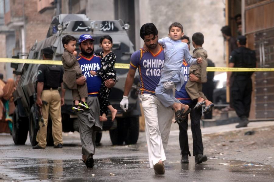 Rescuers evacuate children near the site of an operation in Peshawar, Khyber Pakhtunkhwa province (Xinhua/Umar Qayyum/IANS) by .