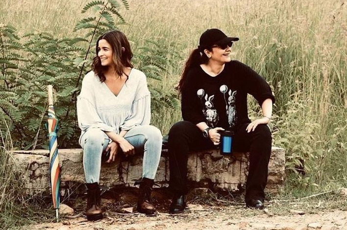 """Actress Alia Bhatt has shared some """"priceless moments"""" with her """"big sister"""" Pooja sister from the sets of """"Sadak 2"""". Alia on Friday took to Instagram and Twitter, where she shared a photograph of herself along with Pooja sitting on a log. Alia is seen in a white tunic paired with light blue denims, while Pooja is sporting an all-black look. by ."""