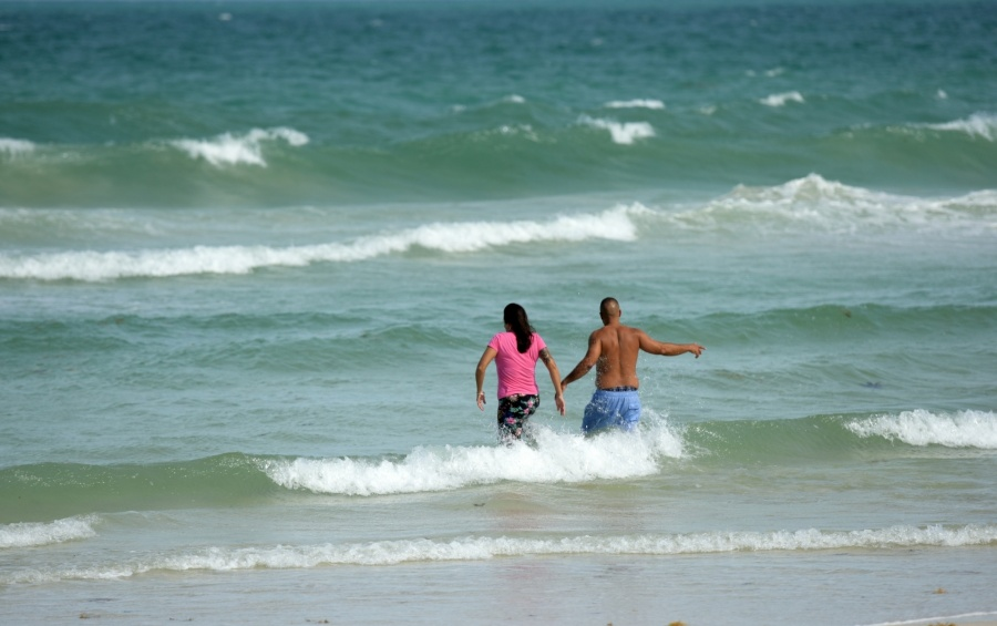 MIAMI, Sept. 9, 2017 (Xinhua) -- People play at a beach as hurricane Irma approaches in Miami of Florida, the United States, Sept. 8, 2017. The U.S. National Hurricane Center said Friday evening that hurricane Irma has strengthened to category five. (Xinhua/Yin Bogu/IANS) by .