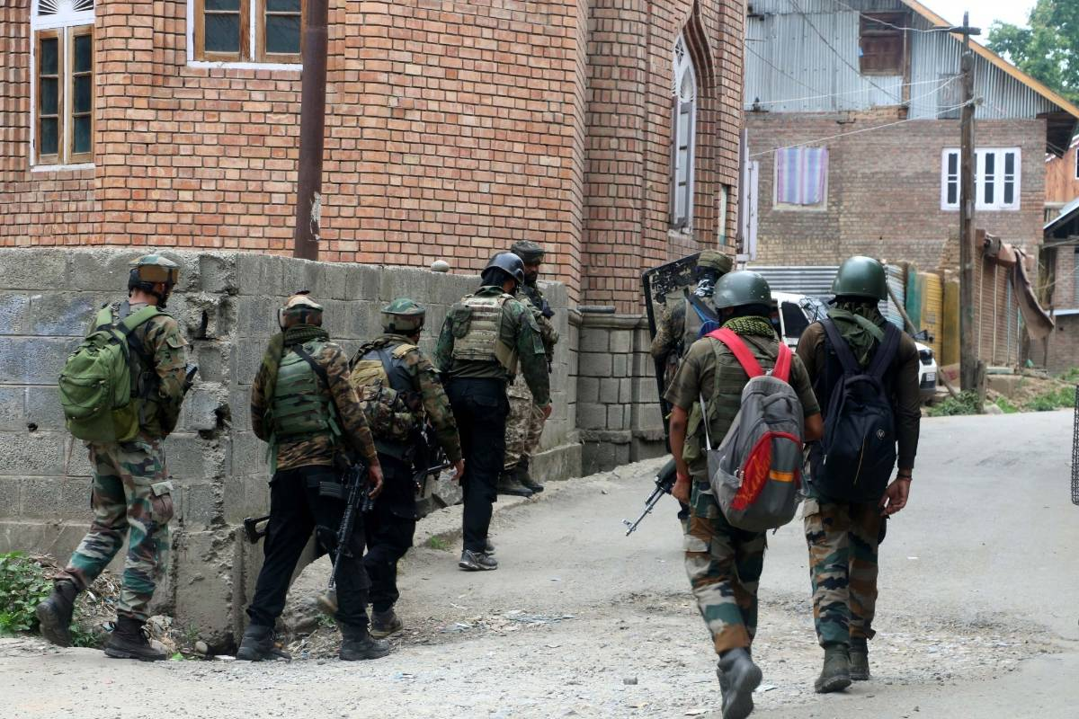 Kulgam: Security personnel carry out cordon and search operations after one terrorist was killed in an encounter at South Kashmir's Kulgam district on July 4, 2020. The encounter started after security forces got an input about the presence of terrorists in Arrah area of Kulgam. (hoto: IANS) by .