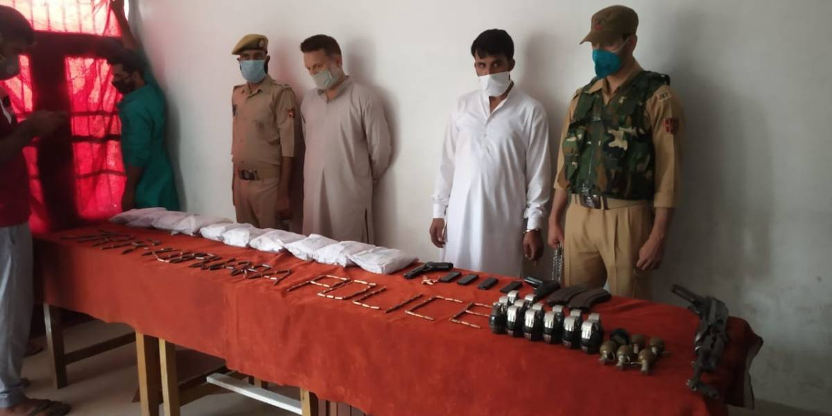 Kupwara: Security forces arrested three persons and seized a consignment of drugs, arms and ammunition in the Kupwara district of North Kashmir on July 26, 2020. A joint team of the army and the police seized 10 kg of brown sugar, 20 grenades, an AK-47 rifle & two pistols, and two vehicles at Sadhna Top in Kupwara. (Photo: IANS) by .