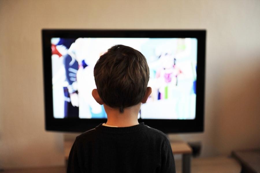 Children watching Television. by .