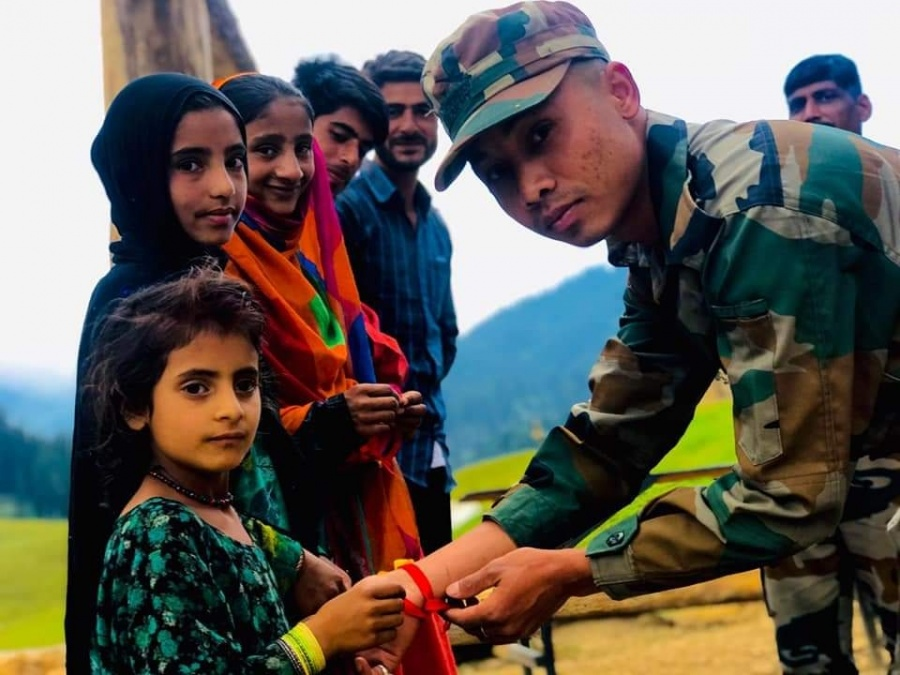 Kupwara: Girls tie rakhis on the wrists of an army personnel in Jammu and Kashmir's Kupwara district on the occasion of Raksha Bandhan on Aug 3, 2020. (Photo: IANS) by .