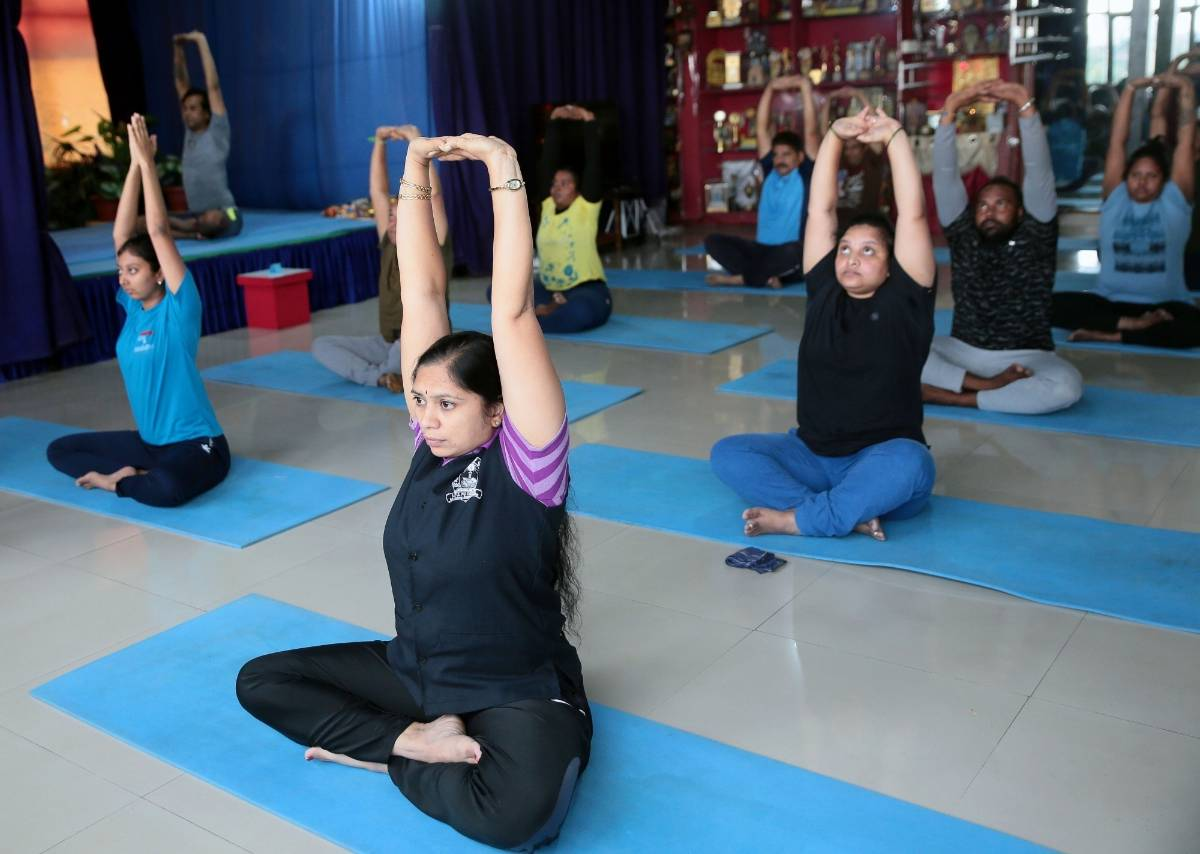 Bengaluru: People perform yogic asanas at SGS International Yoga Foundation centre after yoga centres and gyms re-opened as a part of the third phase of easing of COVID-19 lockdown, in Bengaluru on Aug 5, 2020. (Photo: IANS) by .