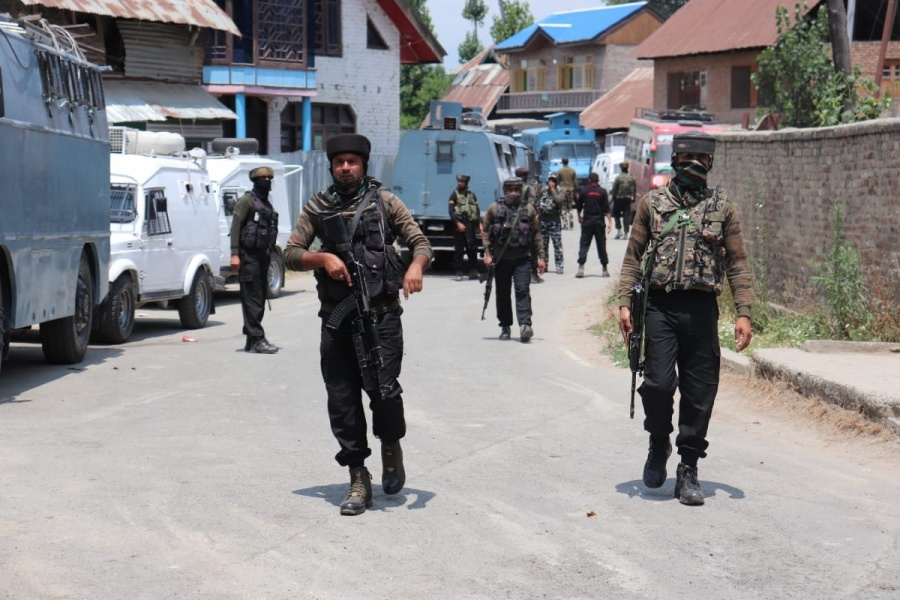 Sopore: Army personnel conduct search operations after encounter that started between terrorists and security forces in Reban area of Sopore in North Kashmir's Baramulla district on Sunday morning ended in the afternoon, on July 12, 2020. The encounter started after security forces got a specific input about the presence of terrorists in the area. As the security forces zeroed in on the spot where terrorists were hiding, they came under a heavy volume of firing triggering the encounter. It was a joint operation by the police and the army. (Photo: IANS) by .
