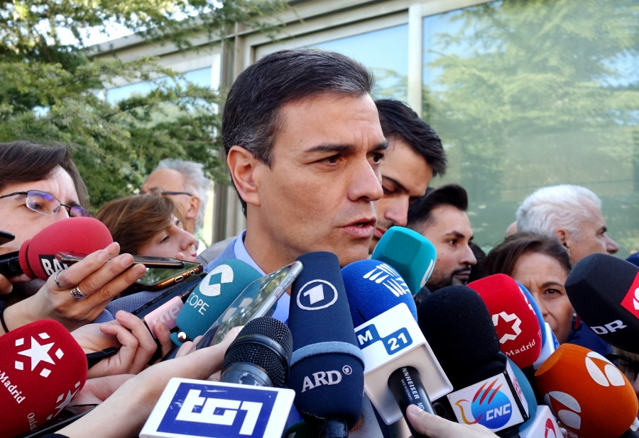 MADRID, April 28, 2019 (Xinhua) -- Spanish Prime Minister Pedro Sanchez (C) speaks to media after casting his ballot at a polling station in Madrid, Spain, April 28, 2019. Spain's polling stations opened on Sunday at 09:00 local time (0700 GTM) for the country's third general election in four years. Close to 37 million voters are called to cast their votes in over 23,000 polling stations located in thousands of municipalities across Spain. (Xinhua/Guo Qiuda/IANS) by .