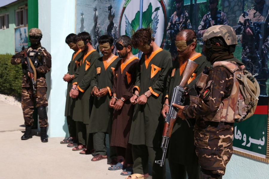 GHAZNI, June 28, 2020 (Xinhua) -- Militants stand handcuffed after being arrested in Ghazni province, eastern Afghanistan, June 28, 2020. Ten militants have been killed as warplanes struck a Taliban gathering in Afghanistan's eastern Ghazni province on Sunday, provincial government spokesman Wahidullah Jumazada said. The security forces also captured six more militants from Ghazni city, the provincial capital, and its surrounding areas over the past couple of days. (Photo by Sayed Mominzadah/Xinhua/IANS) by .